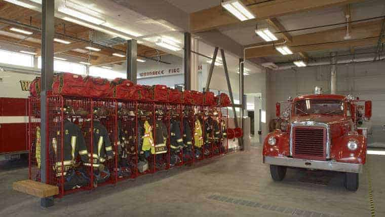 Garage of Waunakee fire station has uniforms and vehicle