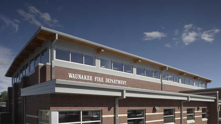 Close up of Waunakee fire department with name displayed on brick building