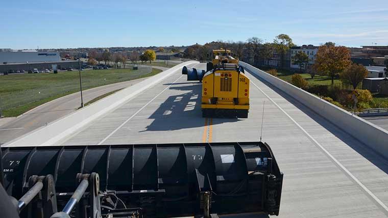 Airport vehicles using perimeter road bridge