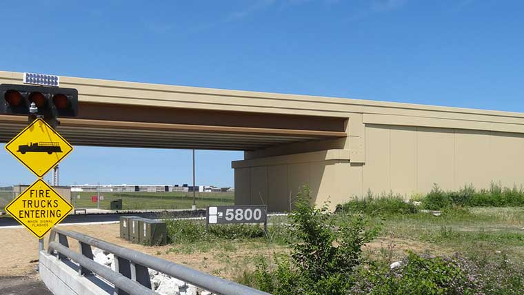Sideview of Milwaukee Airport's perimeter road bridge with signage
