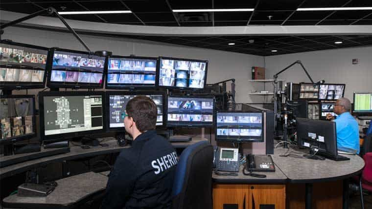 Security guard monitors camera at Sedgwick County Adult Detention Facility