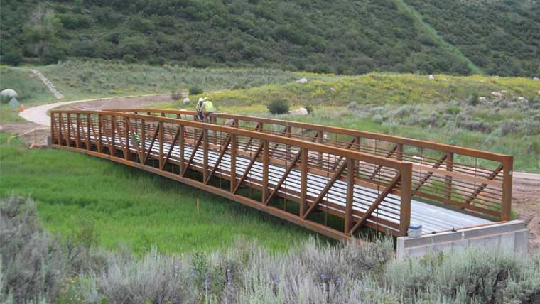 Pedestrian bridge with decorative railing