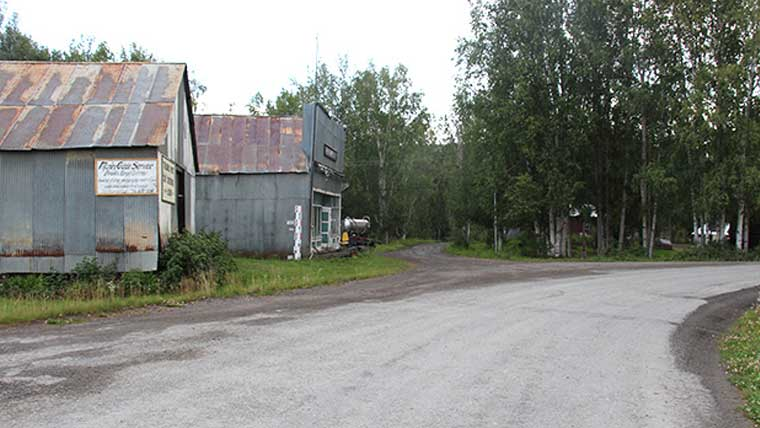 Historic road in Alaska with old buildings