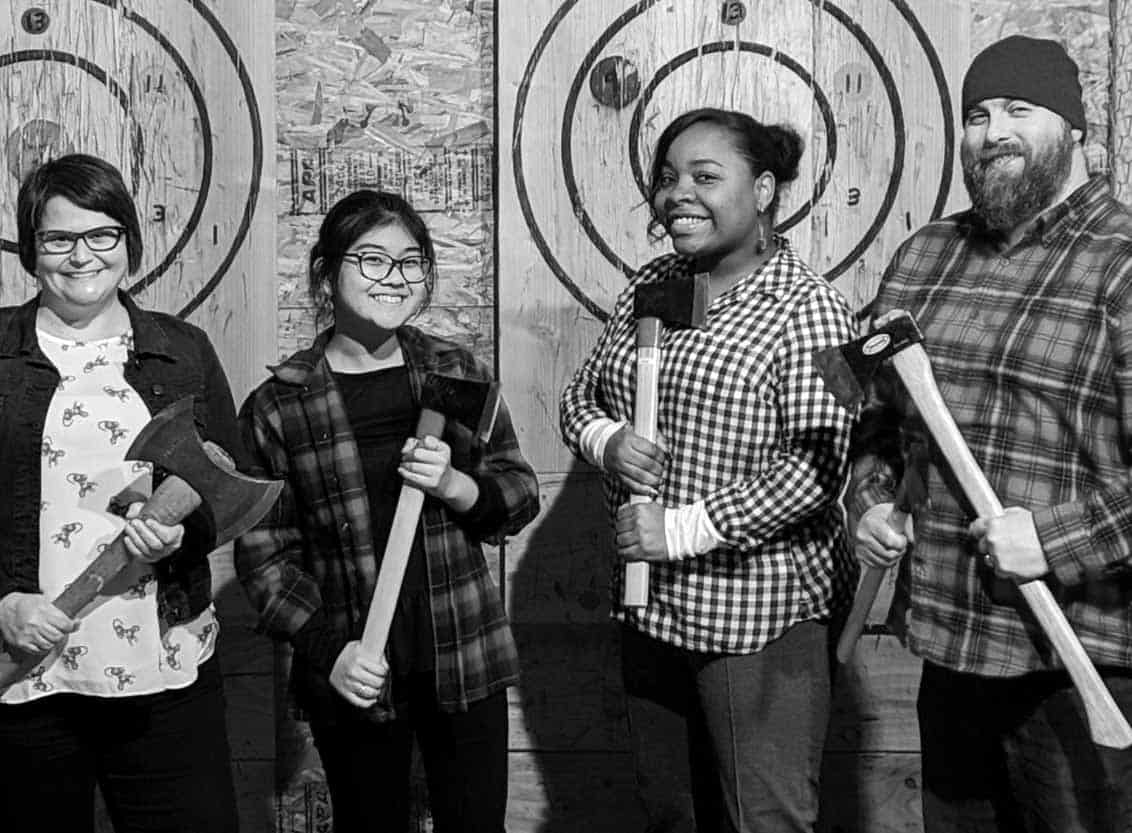 Staff holding axes at employee event