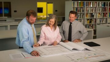 Professionals checking plans for quality control