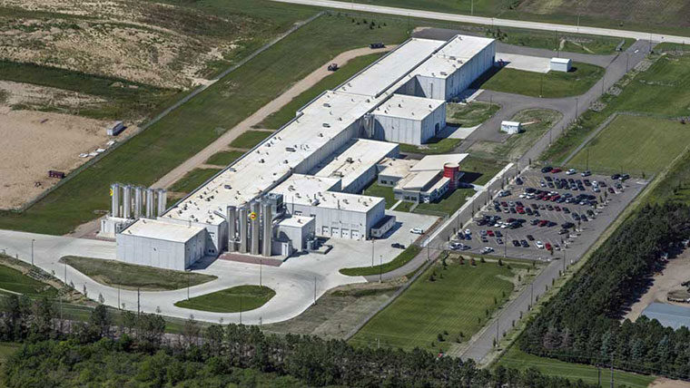 Aerial of greenfield cheese production facility