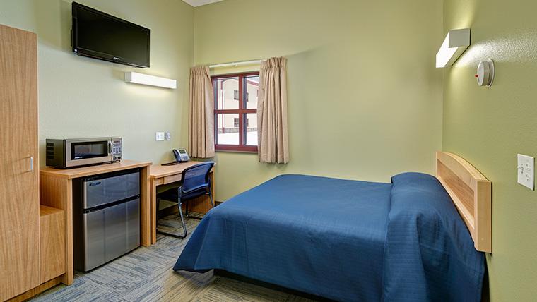 Alpena troop quarters bedroom