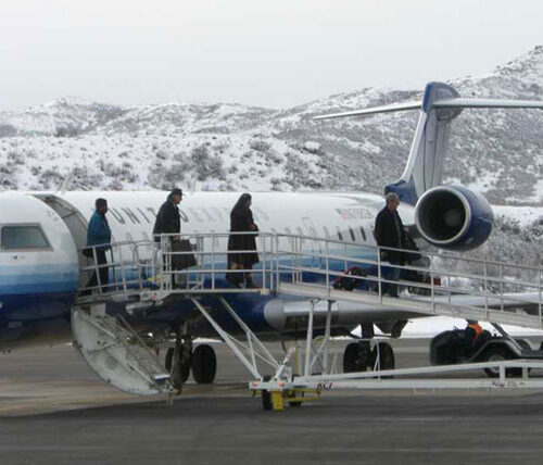 People walking off plane at Aspen-Pitkin Airport