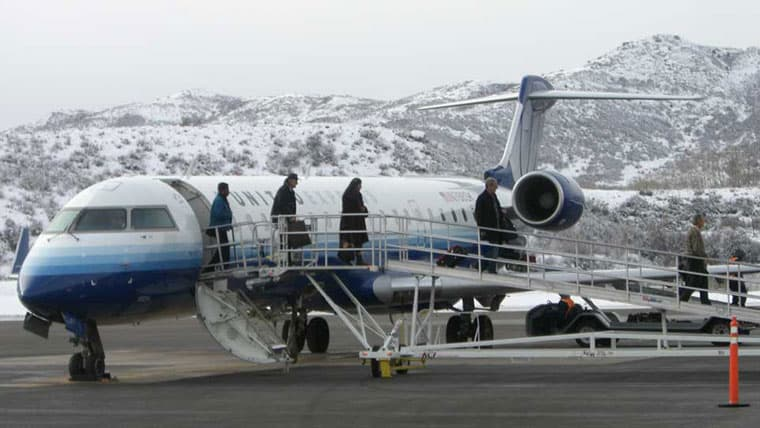 People walking off plane at Aspen-Pitkin Airport
