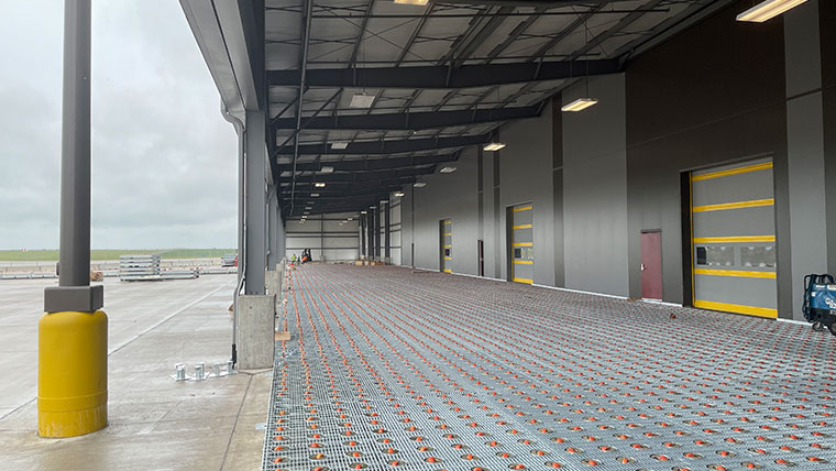 Caster deck at cargo facility