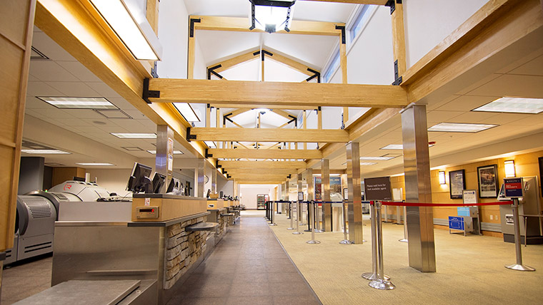 Custom lighting and vaulted ceilings at airport check-in