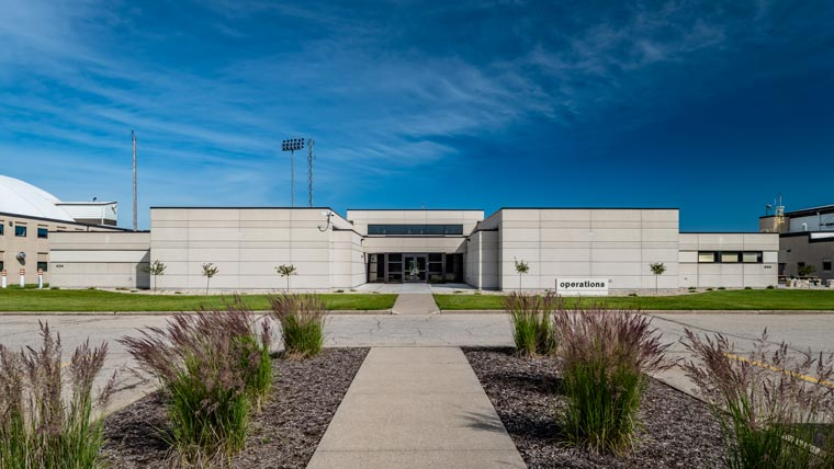 Exterior of Truax Field Squadron Operations Building with landscaping