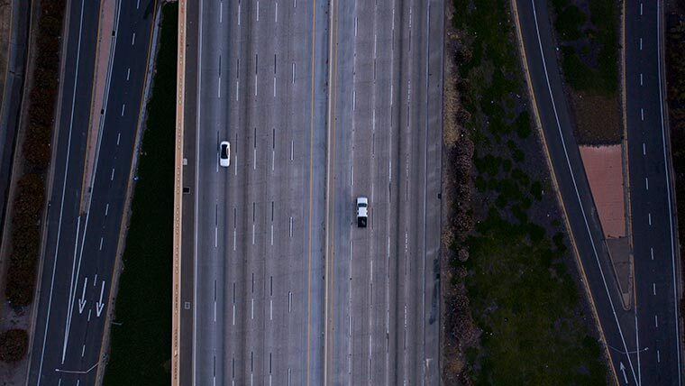 Aerial of highway with only a few cars