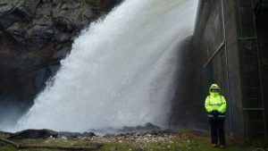 Engineer Jackie Hader stands in front of active spillway