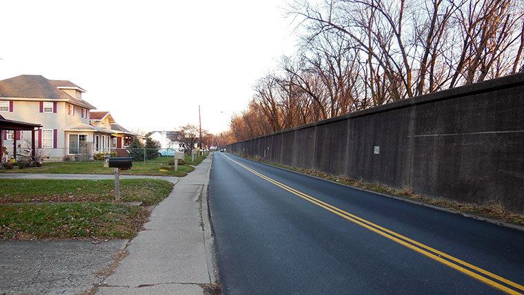 Levee runs along roadway in community