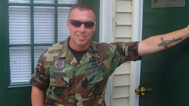 Man in military gear stands in doorway