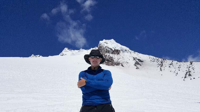 Architect Matt Dubbe stands on mountaintop