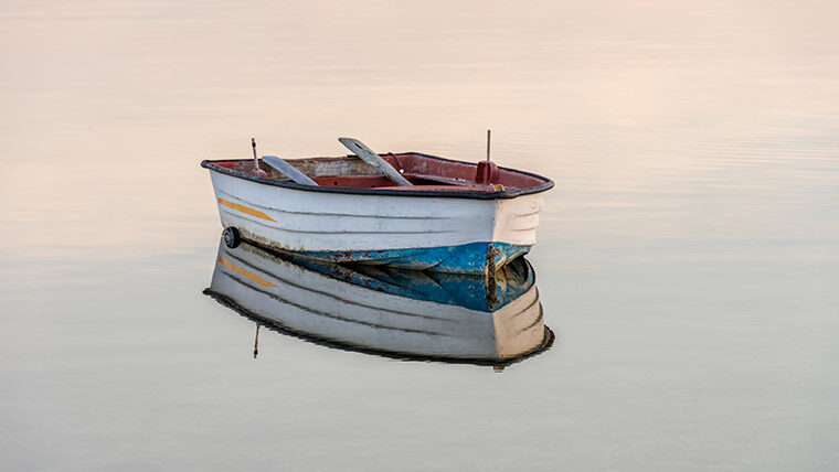 Lone boat sits in a large body of water