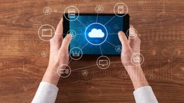 Hands holding tablet with cloud icon