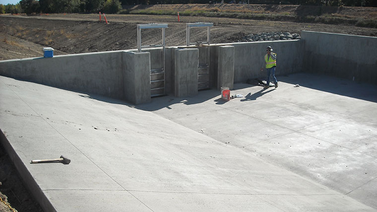 Concrete base poured for Riverside Canal