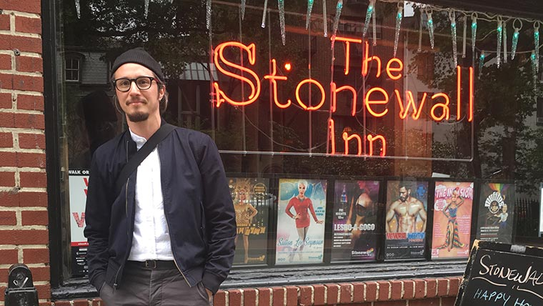 Sebastian Renfield stands in front of The Stonewall Inn