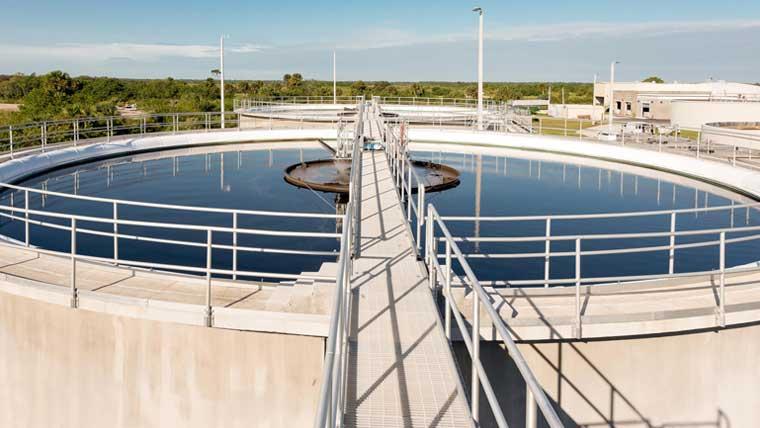 Walkway and tank at wastewater facility