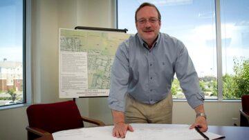 Stephen Sullivan stands at desk