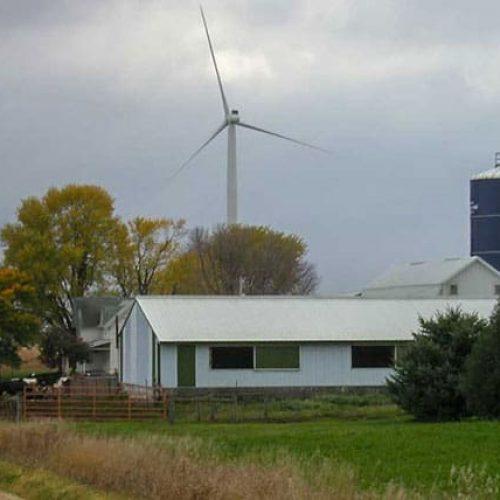 Wind farm with turbine in background