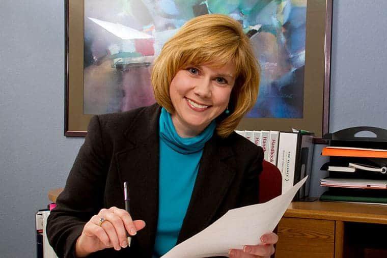 Wendy Culver sits at her desk