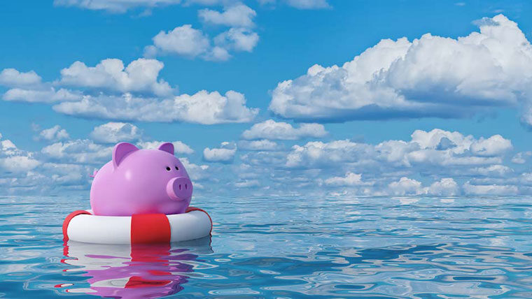 Piggy bank on life raft representing funding sources